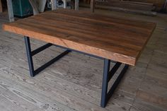 Appalachian Artisan Table by Carolina Farmstead featuring a wood plank top and a metal base