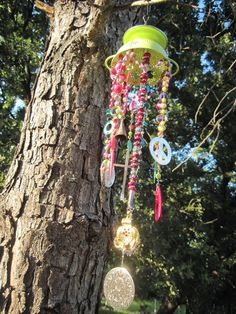 Upcycled Colander Garden Art Windchime by RiverRatCrafts on Etsy.  This is a great trinket for your garden or kitchen window.