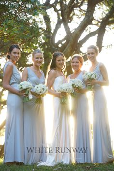 Our gorgeous bride Kate chose the Bridgette Dress by Pia Gladys Perey in Ice Blue for her bridesmaids. #whiterunway #piagladysperey #bridesmaids #weddingfashion #realwedding