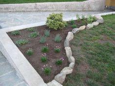 Decorare il giardino con i sassi abbellendo un'aiuola - Decorare il giardino con i sassi abbellendo un'aiuola, un'ottima idea fai da te