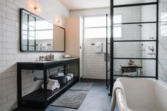 In most bathrooms, the shower enclosure is a bit of an afterthought, just a practical solution for keeping water from spraying all over the room. But lately a different kind of shower enclosure is … Industrial Bathroom Vanity, Modern Bathroom, Small Bathroom, Master Bathroom, Bathroom Ideas, Shower Ideas, Bathroom Black, Minimalist Bathroom, Bad Inspiration