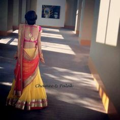 Yellow lehanga with gold work, orange dupatta with antique gold and got pink blouse with deep neck. [Half saree, langa oni] Chamee and Palak: Indian Bridal Wear, Indian Wedding Outfits, Indian Outfits, Indian Weddings, Indian Attire, Indian Ethnic Wear, Indian Style, Simple Lehenga, Desi Clothes