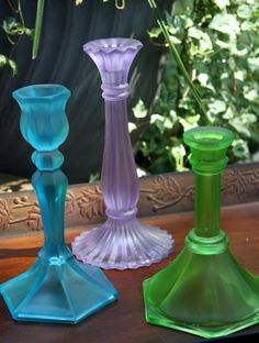 Mix Elmer's Glue and Food Coloring together. Keep adding color to glue until you get right shade. Then paint it on any old glass vase or candlestick. Viola! Beach glass!