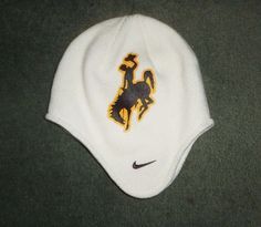 Men's White, Gold & Brown WYOMING COWBOYS NCAA NIKE TEAM Pull Over Knit Hat, GUC #NIKETEAMNCAAMerchandise #UniversityofWyomingCowboys