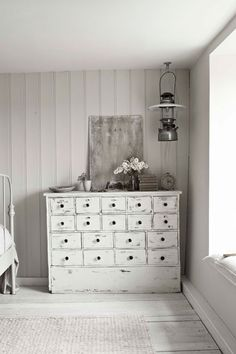 I wouldn't normally consider this my 'style' however, this white/grey room is full of texture and character. It would be like living in a classic black & white movie!
