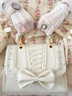 I love the purse and the rings over the gloves. So classy