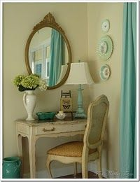 vanity table-I like how this room is predominantly creams with soft turquoise accents. very nice.