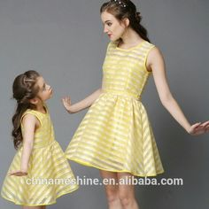 """Mommy and I look good in our yellow dresses."""