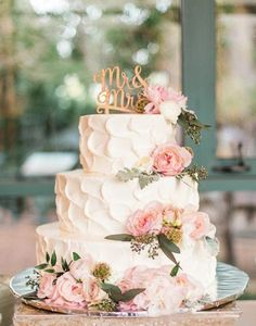 rustic textured wedding cake with pink flowers