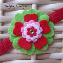 """A layered felt flower that is great for any age! The 2.25"""" flower is made with luxurious wool-blend felt and is topped with a sparkling gem.   It will be attached to your choice of an alligator clip or French barrette that has been partially lined with ribbon, or a 5/8"""" soft and stretchy headba..."""