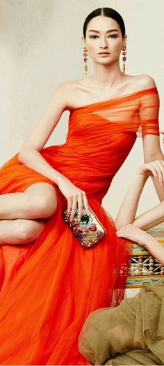 Orange organza will make every head turn when you walk in the room.  This saturated color needs nothing more than a sparkly clutch, earrings and soft makeup.