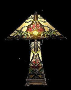 QHS181816This is a beautiful stained glass lamp made with individual hand-cut pieces of glass soldered together to make this gorgeous lamp. It is hand crafted u