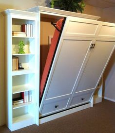 Murphy bed hiding behind sliding bookshelves - A great idea to make a room have double duty as a guest room and office. Description from pinterest.com. I searched for this on bing.com/images
