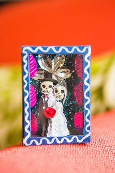 day of the dead wedding statues #dayofthedead #ecofriendlywedding #purplewedding http://www.weddingchicks.com/2014/01/10/lavender-and-white-wedding/