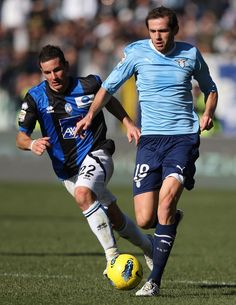 Senad Lulic Photos - Senad Lulic (R) of SS Lazio competes for the ball with Simone Padoin of Atalanta BC during the Serie A match between SS Lazio and Atalanta BC at Stadio Olimpico on January 2012 in Rome, Italy. - SS Lazio v Atalanta BC - Serie A Atalanta Bc, Ss Lazio, Football Predictions, Sport Football, A Team, Sports, Hs Sports, Sport