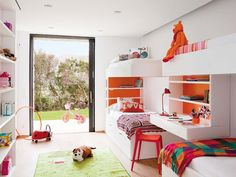 A bunk bedroom for 4 sisters in Spain.  White orange and green color scheme.  Modern cute!