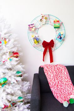 Don't stuff your holiday cards in a drawer, display them this season on a easy to make card wreath! by Sarah Hearts