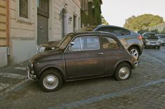 Fiat 500 with a sad looking rear tyre, Rome 2011.