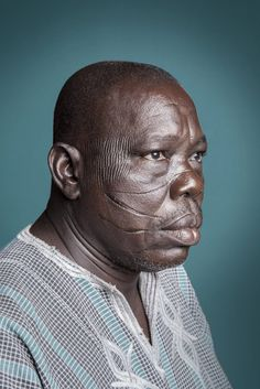 """""""During wars, Mossi and Ko tribes would recognize each other, and therefore avoid killing one another. It was a way of recognition. No need for an ID card, I already wear my identity card on my face.""""—Mr. Mien Guemi of the Ouro Bono from Burkina Faso."""