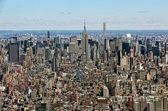 Empire State Building and the Midtown manhattan Skyline as seen from the One World Observatory on top of the World Trade Center in New York City. Buy fine art canvas prints, framed prints, acrylic or metal prints of New York City photos by Nishanth Gopinathan. Perfect as wall decor for your home or office.