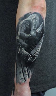 Grey 3D Strumming Guitar Tattoo For Men On Arms
