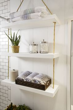 Looking to liven up your builder grade bathroom on a budget? Add depth to bathroom walls by installing and painting inexpensive wall paneling. Satisfy your storage needs with suspended shelves. Amber Interiors makes easy improvements that leave this bathroom modernized with a rustic twist.