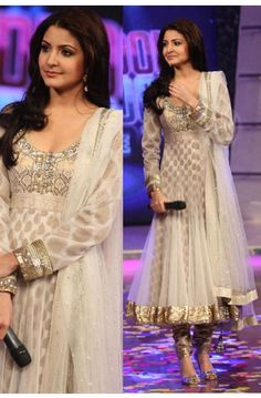 Bollywood style Salwar Kameez.  Perhaps refers to the full skirt, which would move well on stage?
