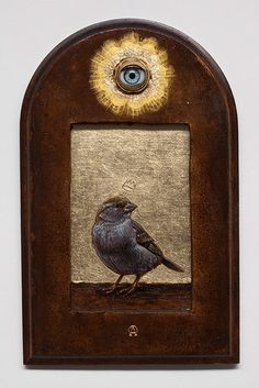The all seeing eye combined with an adorable bird.... Hmm?