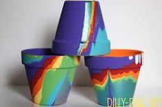 Create these rainbow pots with pour painting - a super fun and creative painting technique!