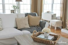 Real Life With A White Slipcover & Keeping It Pretty sofa and covered stool in background