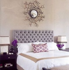 love the purple ikat pillows and that mirror!