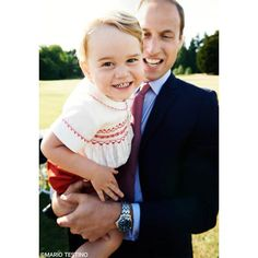 Kensington Palace has released a new official photo of Prince George ahead of his second birthday. The photo shows George, who turns two on Wednesday, grinning at the camera as he sits in the arms of his father Prince William. The photo was taken by Mario Testino following Princess Charlotte's christening on 5 July, and sees an excited George looking as cute as ever in his red shorts and matching smocked top by Rachel Riley.
