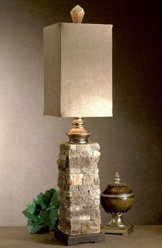 Stone Look Accent Lamp Western Lamps - Faux stone finished in varying tones of ivory and browns with cast aluminum accents. Square drum shade in brushed palomino sueded fabric.