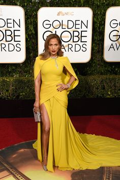 Jennifer Lopez is known for rocking revealing, barely there dresses on the red carpet, but this year she's incorporating a little more fabric and some serious color into her looks.
