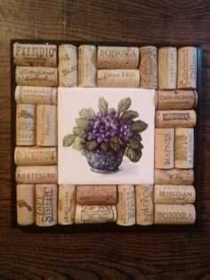 Great gift idea for the wine lover. We have such fun making these trivets. We don't cut the corks to maintain their integrity, so it is a big jigsaw puzzle. Wine Cork Trivet with Tile by UNCORKEDbyFREDandPAM on Etsy, $28.00Wine Cork Trivet/Wall Art African Violets by UNCORKEDbyFREDandPAM, $28.00