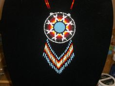 native american necklace approx. 2 3/4 dia. approx. 29 necklace deer hide back with AC stamped on it all hand made 100% native made