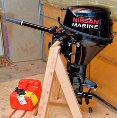 Step-by-step instructions on building a basic and strong stand for holding an outboard motor.