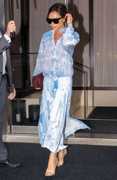 Victoria Beckham in a blue printed outfit - click through to see more street style!