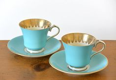 Two, vintage, Tiffany blue and gold-trimmed, made in England, Ansley, teacup and saucer sets. What I love most about this set is that the cups are