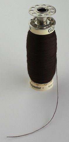 Awesome hack!  No more buying four cones of a color of serger thread that you will need for 1-2 small projects!  a conebobbinspool of serger thread by moonthirty, via Flickr