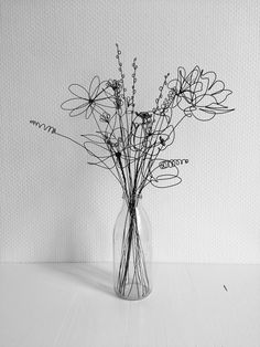 The actual line of the wire in this sculpture creates a drawing of the flowers in the vase. The actual line of the wire in this sculpture creates a