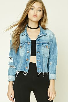 A denim jacket featuring a distressed design, button front, basic collar, two front buttoned flap chest pockets, cropped silhouette, a raw-cut hem, and long button cuff sleeves.