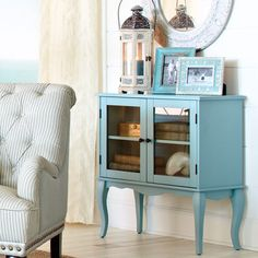 Toscana cabinet ~ Petite French farmhouse charm include cabriole legs, scalloped apron and a soft blue-gray painted finish set off by zinc hardware. Tempered glass doors.