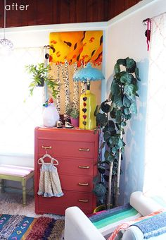 bohemian baby nursery ideas.  love the pops of vibrant colors.  great DIY projest