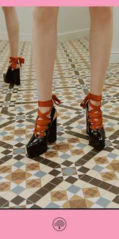 Discover the Track Lace-up Pumps in Black. This dramatic lace-up slingback style comes with both Black and Bright Orange laces for either a classic or more playful look. The black rubber sole has been custom-moulded to leave graphic tracks. The platform adds a stabilising feature that is comfortable to walk in and wear all day.