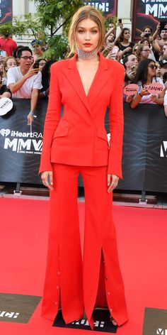As the host of the 2016 MuchMusic Video Awards, Gigi Hadid switched outfits a whopping total of four times, first kicking off her stylish streak in a sizzling red-hot blazer with a pair of matching wide-leg central-slit pants by Mugler, complete with a sparkly Fallon choker, Norman Silverman diamond studs, and black-and-red sandals.
