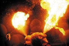 Jeff Behrends and Ben Truwe breathe fire in downtown Medford Ore., Nov 16, 2007.