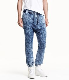 Jogging-style pants in washed stretch denim. Elasticized drawstring waistband, side pockets, welt pockets at back, and elasticized hems. | H&M Divided Guys
