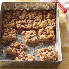 Strawberry Oatmeal Bars Recipe -Their fruity filling and fluffy coconut topping make these bars truly one of a kind. They really dress up my trays of Christmas goodies. —Flo Burtnett, Gage, Oklahoma