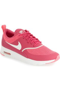 Crushing on this sporty low-profile sneaker by Nike in a bright pop of pink.